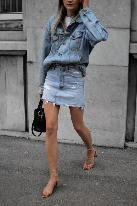 a stylish outfit with a white t-shirt, a blue denim mini, a blue denim jacket and nude strappy sandals
