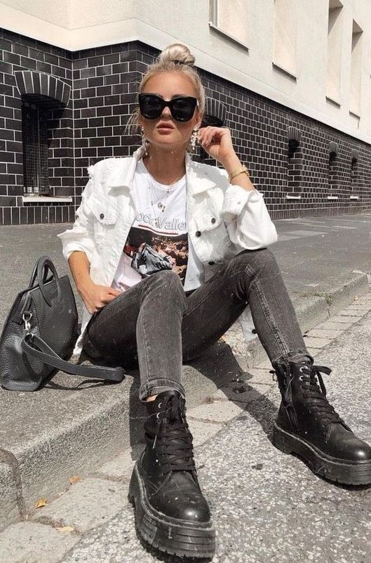 16 a printed tee, grey jeans, black combat boots and a white denim jacket plus a grey bag