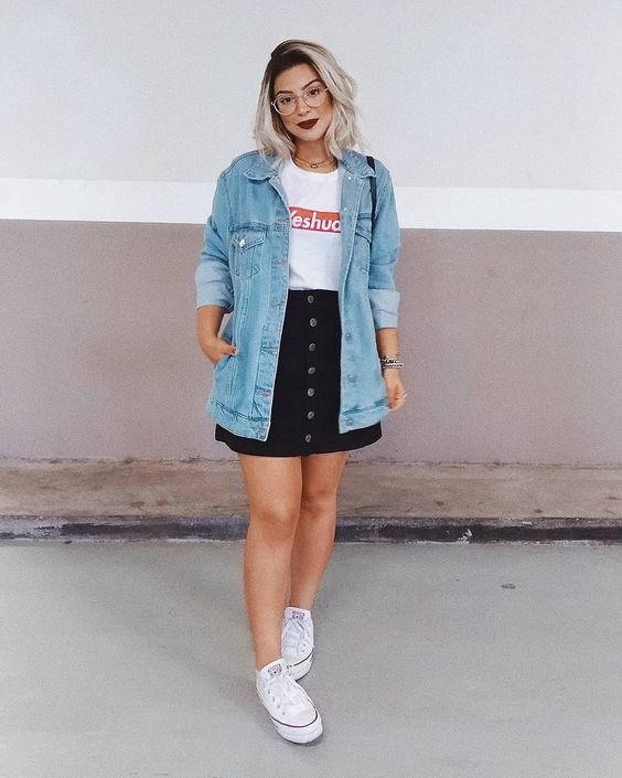 a white printed t-shirt, a black button up denim mini, a blue denim jacket and white sneakers