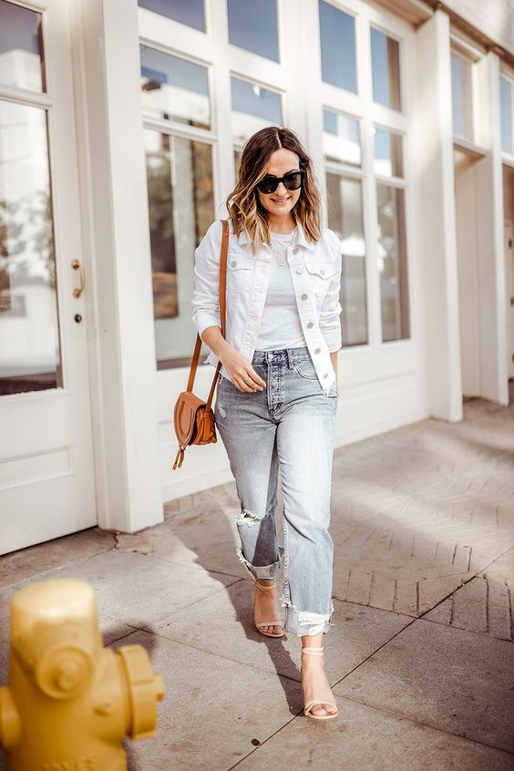 20 a white t-shirt, a white denim jacket, blue ripped jeans, strappy heels and a brown bag for spring