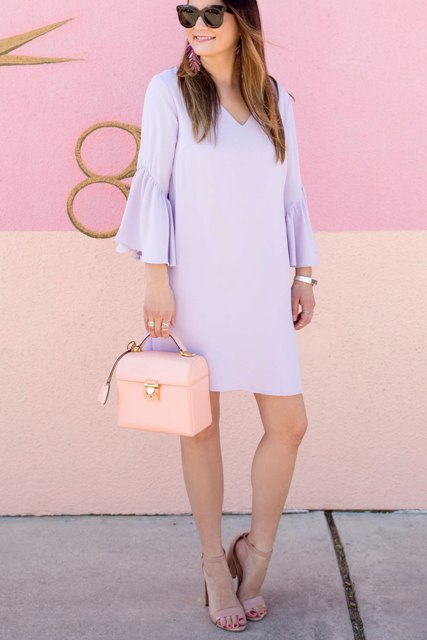 With bag, sunglasses and beige high heels