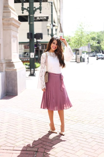 With beige bag, pink pleated midi skirt and beige pumps