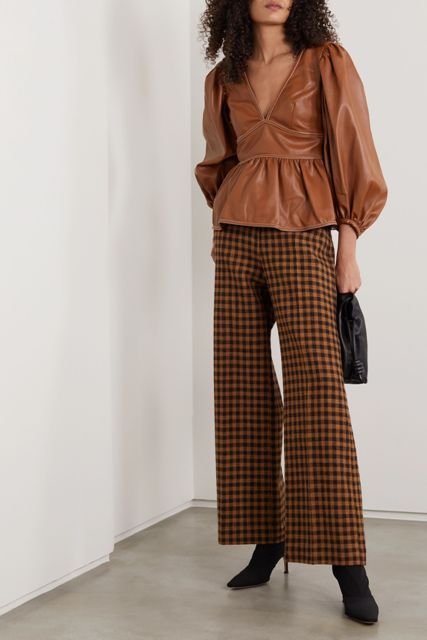 With black and brown checked palazzo pants, black bag and black heeled boots