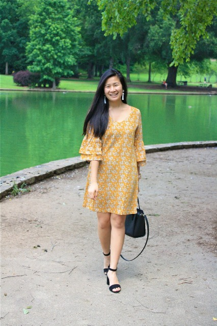 With black bag and black low heeled shoes