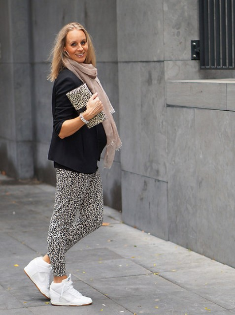 With black blazer, pale pink scarf, leopard printed clutch and white sneakers
