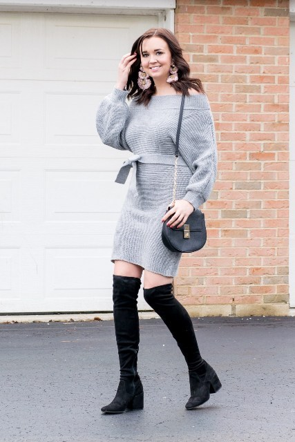 With black leather bag and black over the knee boots