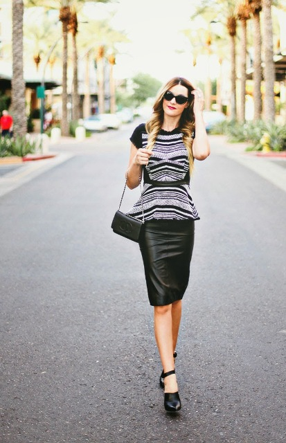 With black leather pencil skirt, high heels and black chain strap bag