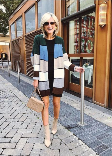 With black mini dress, beige bag and color block cardigan