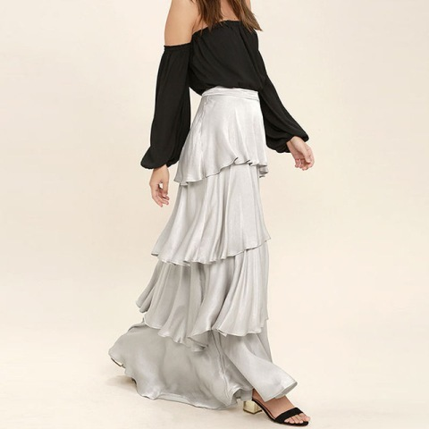 With black off the shoulder blouse and black and golden sandals