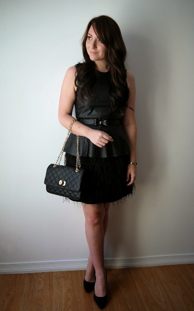 With black skirt, chain strap bag and black pumps