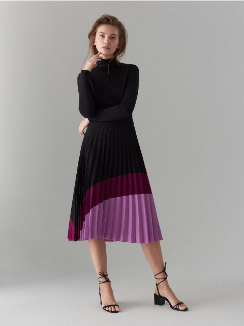 With black turtleneck and black lace up low heeled shoes