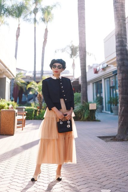 With blazer, black leather beret, mini bag and black and white mules