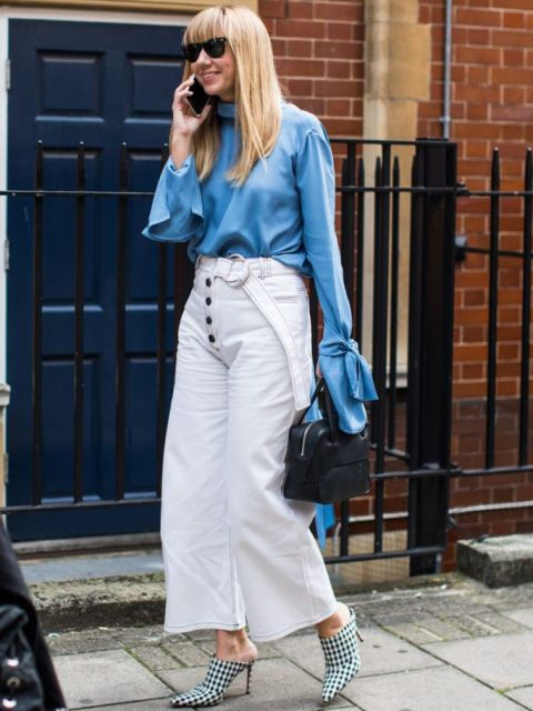 With blue long sleeved blouse, black bag and black and white checked mules
