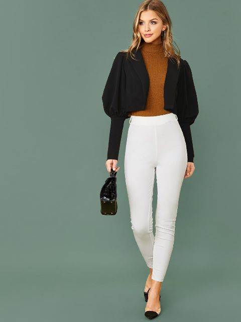 With brown turtleneck, white high-waisted pants, black leather bag and black and beige low heeled shoes