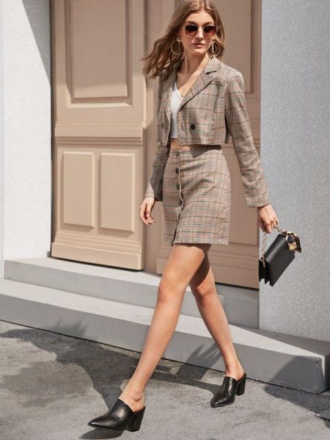 With checked button front skirt, black bag and black mules
