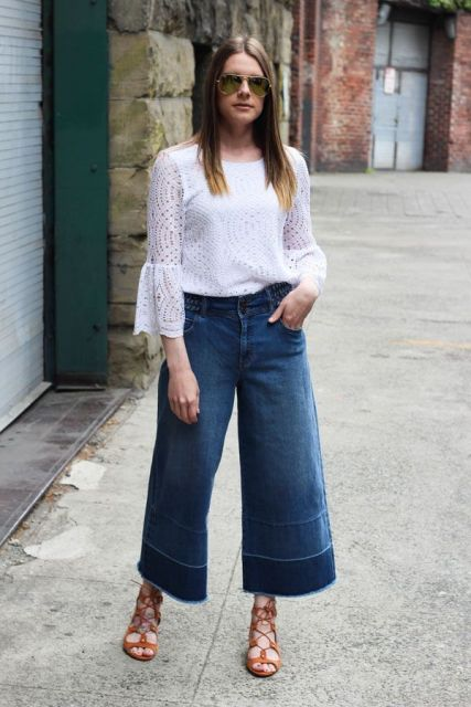With denim culottes and lace up sandals