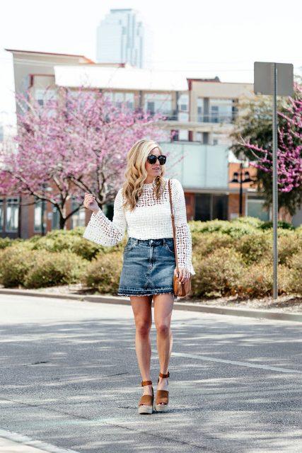 With denim mini skirt, brown bag and brown platform sandals