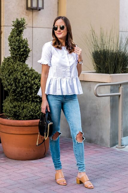 With distressed jeans, beige low heeled sandals and black bag