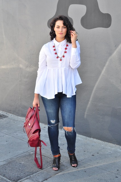 With distressed jeans, red bag and black cutout shoes