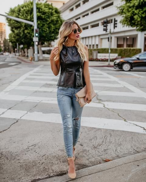 With distressed skinny jeans, beige clutch and beige ankle strap shoes