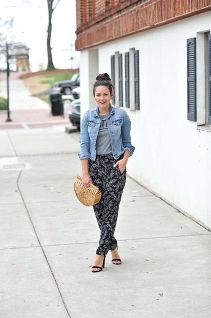 With gray t shirt, denim jacket, straw bag and black sandals