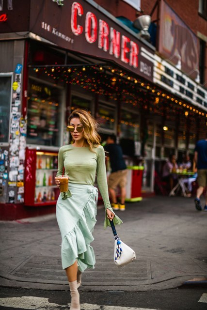 With green bell sleeved shirt, mint green wrap skirt and white bag