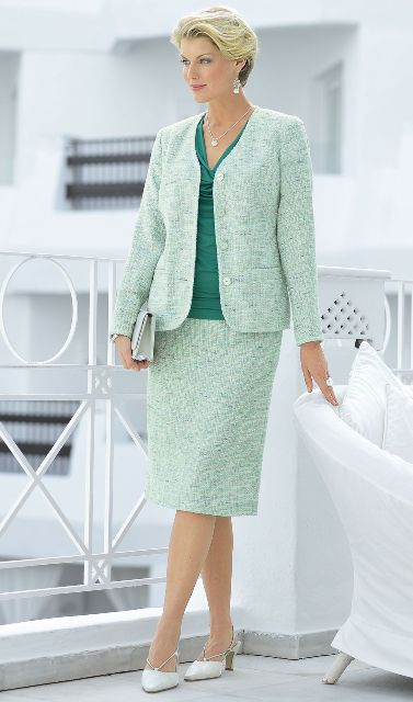 With green blouse, clutch and low heeled shoes