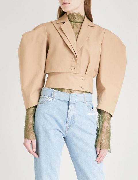With green lace long sleeved blouse and light blue jeans
