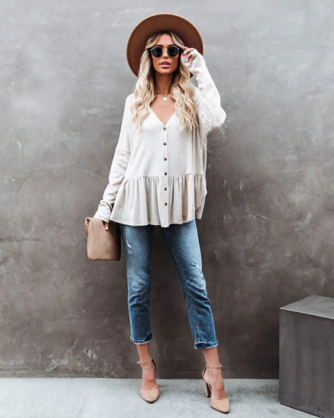 With hat, cropped jeans, beige suede clutch and beige ankle strap shoes