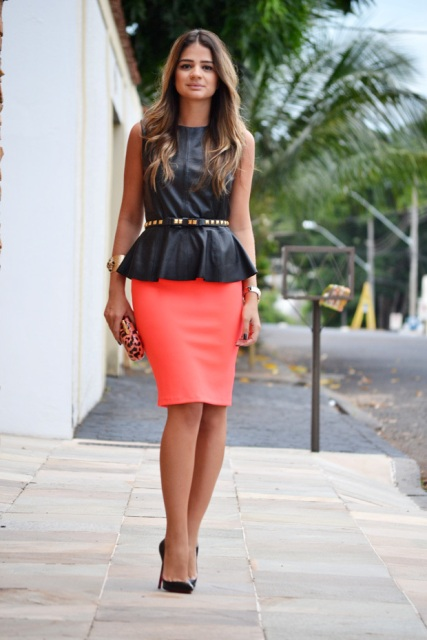 With leopard clutch, black pumps, embellished belt and pink skirt