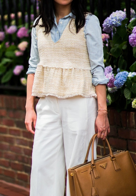 With light blue button down shirt, white palazzo pants and brown leather tote bag