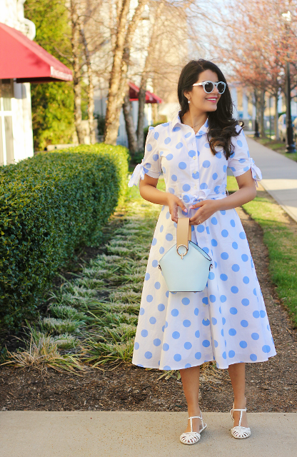 With light yellow and blue bag, white flat shoes and sunglasses