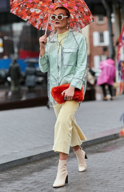 With light yellow culottes, shirt, mint green jacket and red faux fur clutch