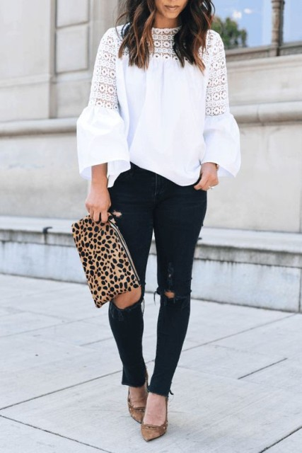 With navy blue distressed jeans, brown shoes and leopard printed clutch