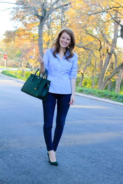 With navy blue jeans, emerald bag and emerald pumps