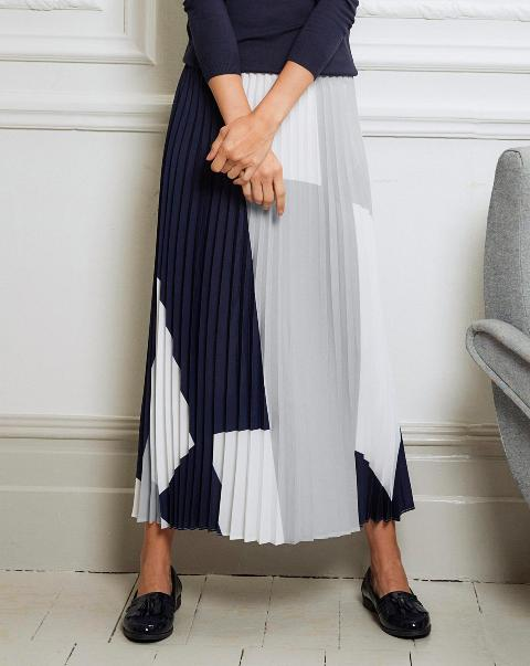 With navy blue shirt and black patent leather flat shoes