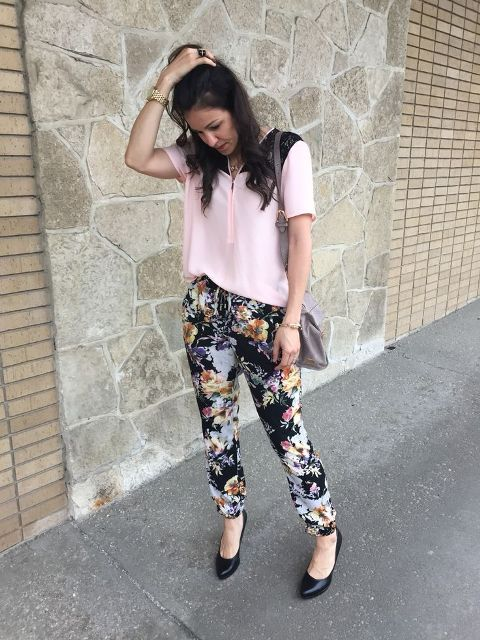 With pale pink blouse, gray bag and black pumps