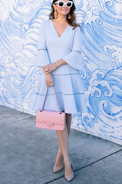 With pale pink leather bag and beige pumps