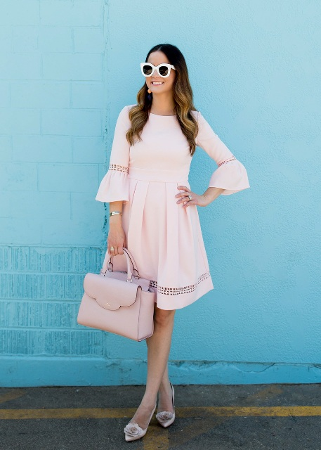 With pale pink leather bag and embellished shoes