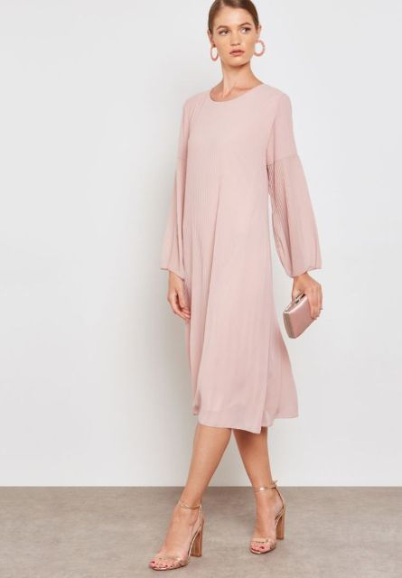 With pale pink mini clutch and golden high heels