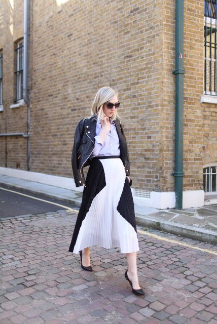 With pastel colored shirt, black leather jacket and black pumps