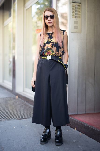With printed top, black platform shoes and bag
