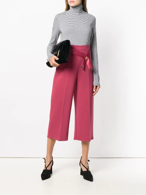 With printed turtleneck, black velvet clutch and black lace up shoes
