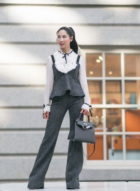 With ruffle blouse, gray bag and gray tweed flare trousers