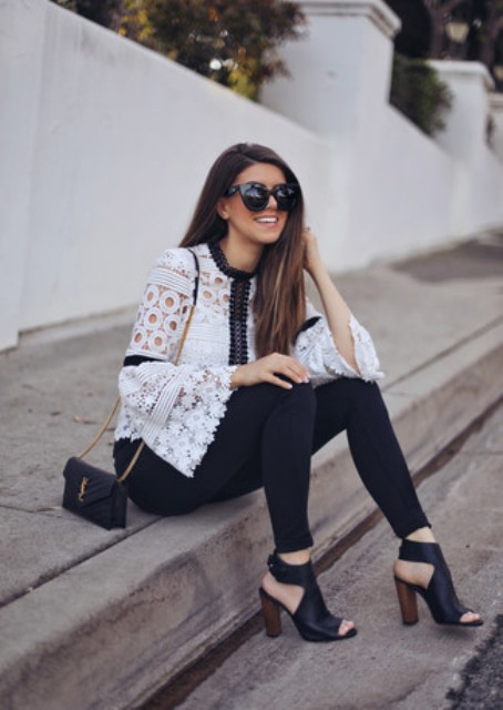 With skinny pants, black cutout shoes and chain strap bag