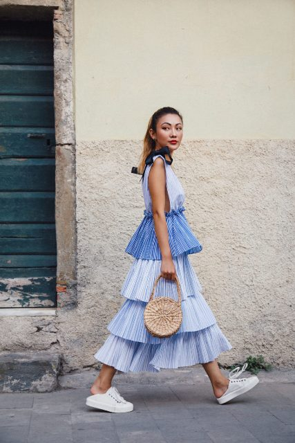With straw rounded bag and white flat shoes