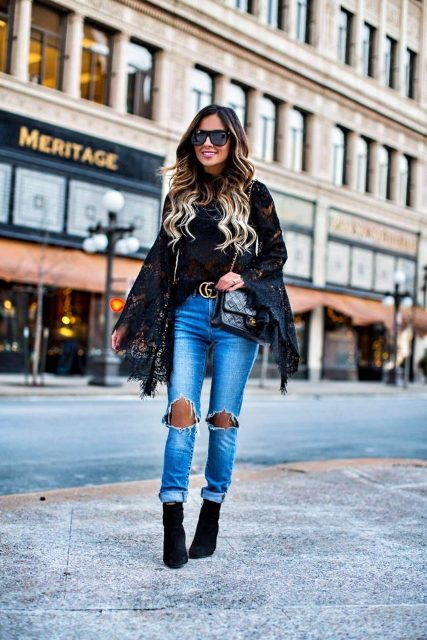 With super distressed jeans, belt, chain strap bag and black suede ankle boots