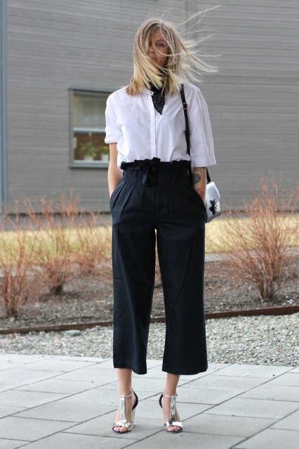 With white button down shirt, black bag and silver shoes
