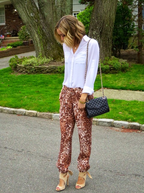 With white button down shirt, chain strap bag and beige sandals