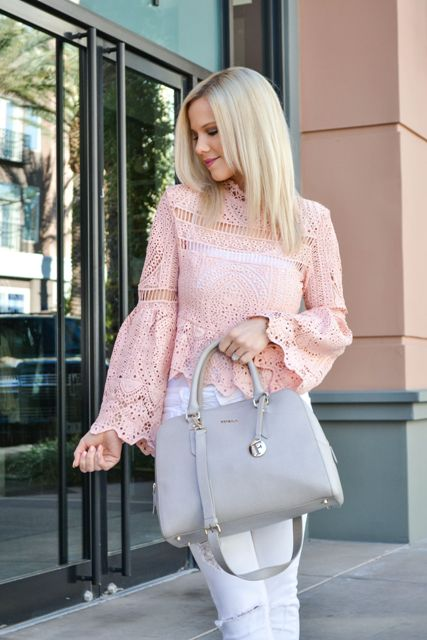 With white distressed jeans and gray leather bag